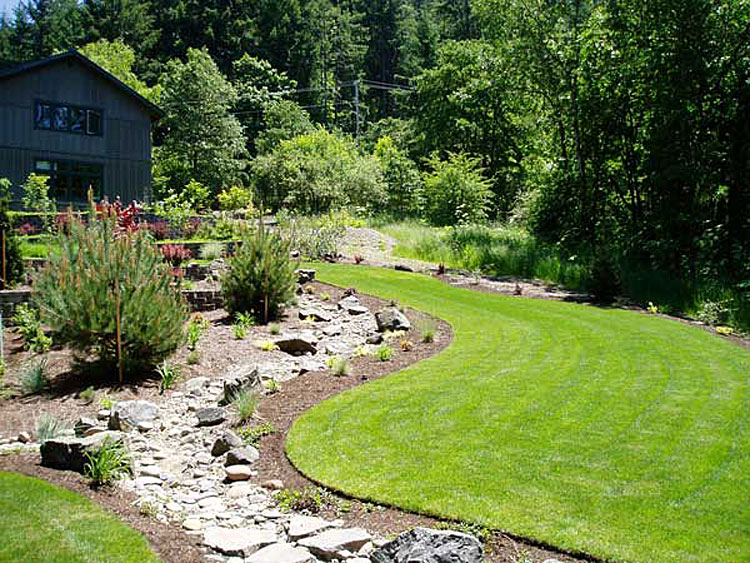 Drainage and creek bed installation for Wet garden designs