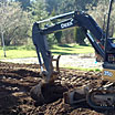 Our large excavator is clearing away the dirt on this Lane County property